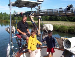 kids learning to steer the boat in the Canals in Europe